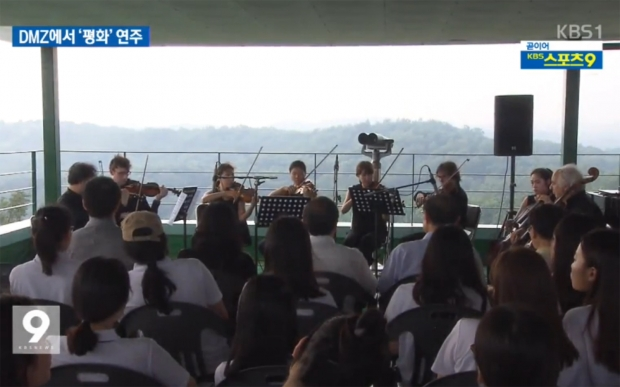 German School of Music Weimar viola professor Erwan Richard and 3rd-year viola student Lee Hyun Kyung perform with chamber orchestra at a Concert for Unification at DMZ during the 5th Yeoncheon DMZ International Music Festival, 30 August 2015. Image: KBS News